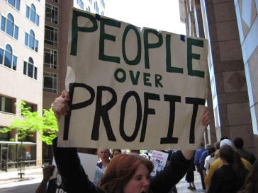 Protest sign of People over Profit CC license